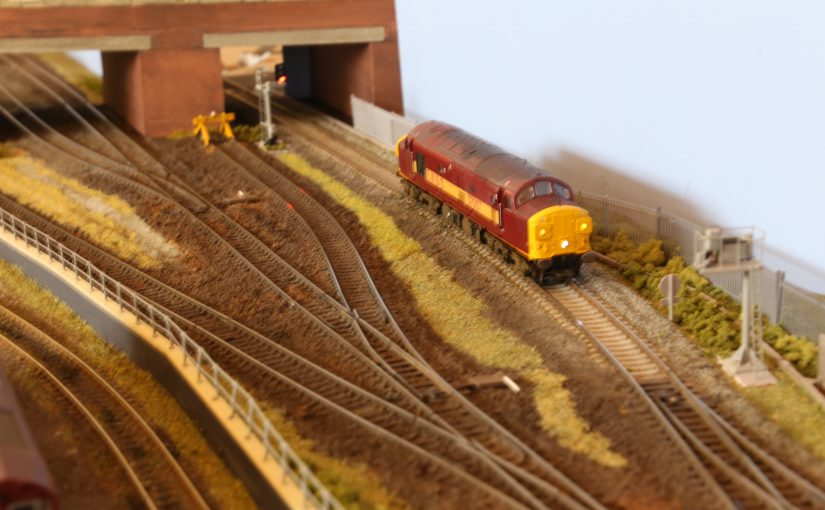 Class 37 loco in EWS livery waiting for its next duty.