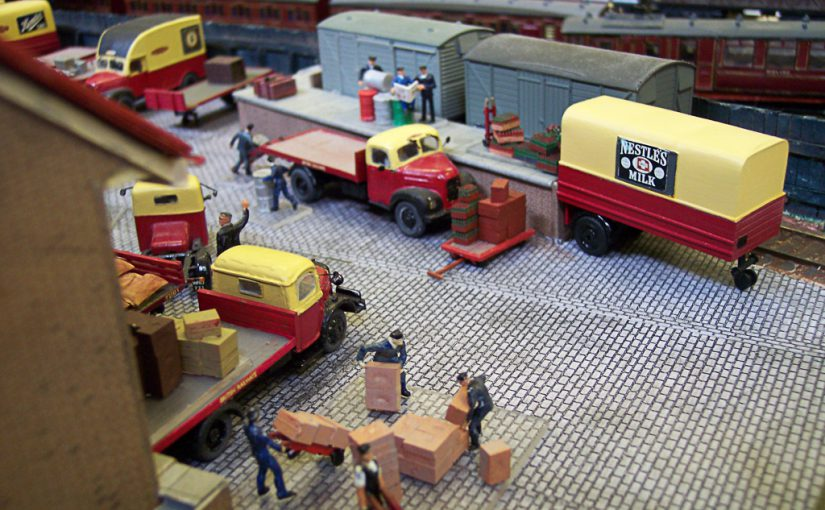 BR era Goods Depot, with Scammell mechanical horses and vans being unloaded