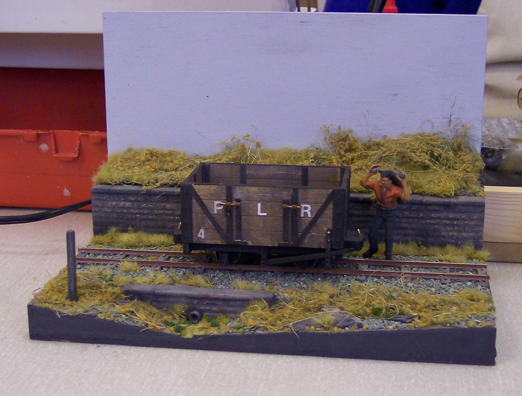 Narrow-gauge diorama, open coal truck being loaded by hand